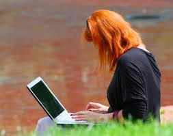 redhead on computer