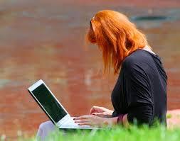 redhead on computer